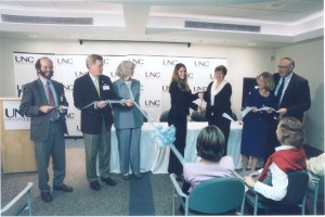 Jennifer and Rita cutting the ribbon at our program opening in 2003